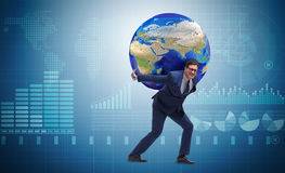 The businessman carrying earth on his shoulders Royalty Free Stock Photography