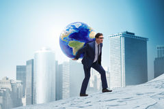 The businessman carrying earth on his shoulders Royalty Free Stock Photo