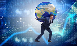 The businessman carrying earth on his shoulders Stock Image