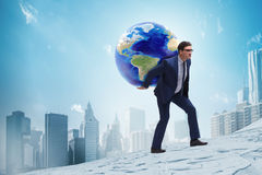 The businessman carrying earth on his shoulders Royalty Free Stock Image