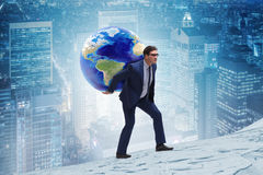 The businessman carrying earth on his shoulders stock photos