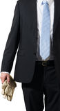 Businessman carrying gloves. Businessman ready to put on some gloves to do the dirty work stock photography