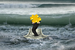 Businessman carrying gold puzzle on money boat with oncoming waves. Businessman carrying 3D gold puzzle on money boat in sea with wave coming royalty free stock photos