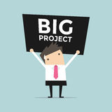 Businessman carrying a heavy big project Stock Images