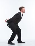 Businessman carrying heavy load on his back Royalty Free Stock Photos