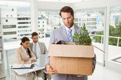Businessman carrying his belongings in box Stock Photo