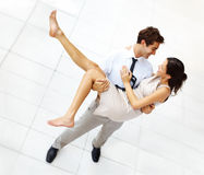 Businessman carrying his cute girlfriend Stock Image