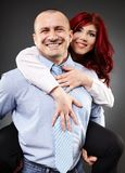 Businessman carrying his partner in the back Royalty Free Stock Photography