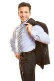 Businessman carrying jacket Royalty Free Stock Image