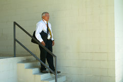 Businessman Carrying Laptop Going Down Steps Stock Images