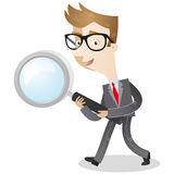 Businessman carrying magnifying glass Stock Photo