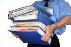 Businessman is carrying many file folders Stock Photos