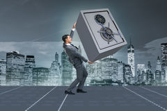 The businessman carrying metal safe in security concept Royalty Free Stock Image