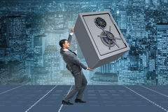 The businessman carrying metal safe in security concept Stock Image
