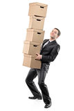 Businessman carrying paper boxes Royalty Free Stock Image