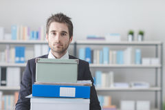 Businessman carrying a pile of boxes and folders Royalty Free Stock Photography