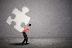Businessman building puzzle Stock Image