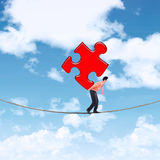 Businessman carrying puzzle on the rope 1 Stock Photos