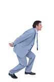 Businessman carrying something with his back and hands Royalty Free Stock Images