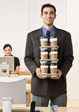 Businessman carrying tray of coffee. Businessman carrying a tray of coffee Stock Images