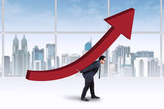 Businessman carrying an upward chart Stock Images