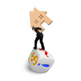 Businessman carrying wooden house balancing on dice Royalty Free Stock Image