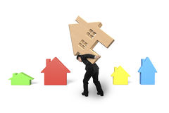 Businessman carrying wooden house on his back Stock Image