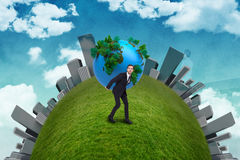 Businessman carrying the world Stock Image