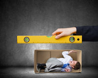 Businessman in carton box Stock Photos