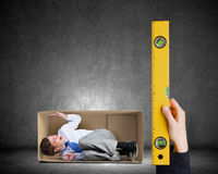 Businessman in carton box Royalty Free Stock Images