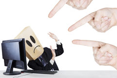 Businessman with carton head bullied Royalty Free Stock Photos