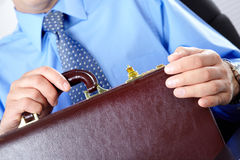 Businessman with case Stock Photography