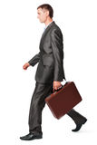 Businessman with case walking. Isolated on white background Royalty Free Stock Photography