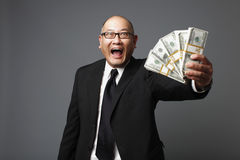 Businessman with cash Royalty Free Stock Photos