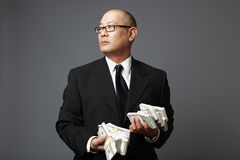 Businessman with cash Royalty Free Stock Photography