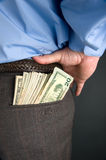 Businessman with cash in back Stock Image