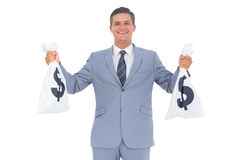 Businessman with cash bag in each hands Stock Photography
