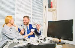 Businessman with cash bank client. Office manager hold bank card. Man business owner sit office pile of money. Bank royalty free stock photos