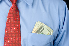 Businessman with cash in pocket Royalty Free Stock Photo