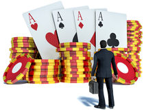 Businessman and casino chips with cards Royalty Free Stock Image