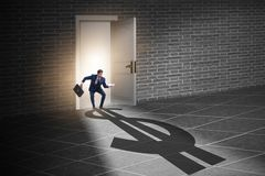 The businessman casting shadow in dollar shape royalty free stock photo
