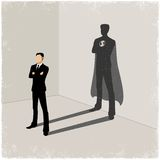 Businessman casting superhero shadow Stock Images