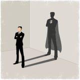 Businessman casting superhero shadow Stock Images