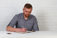 Businessman in casual cloth reading and signing document in office. Businessman hipster signs the document. Success, serious busin. Businessman in casual cloth stock photos