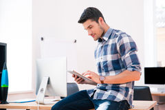Businessman in casual cloth using tablet computer Stock Photos