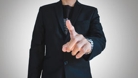Businessman in casual suit pointing finger, selective focus on hand Royalty Free Stock Photos