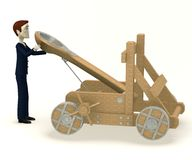 Businessman with catapult Stock Photography