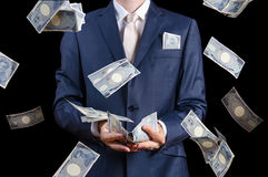 White businessman catches falling money. White businessman catching falling japanese money Stock Images