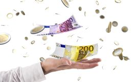 Businessman catches money that rains from sky. Concept of success in business. Affairs royalty free stock images