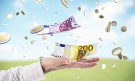 Businessman catches money that rains from sky. Concept of success in business. Affairs stock illustration